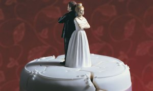 A Wedding Cake, bride and groom standing back to back